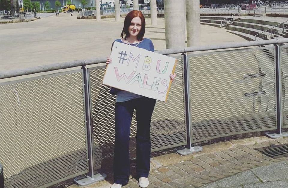 A photo of Charlotte with a sign that read #MBUWales